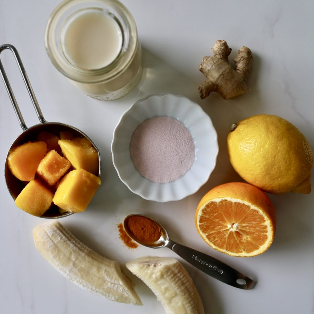 Ingredients of immunity boosting smoothie. 1 frozen banana 1 cup coconut milk ½ cup frozen mango ½ lemon, squeezed ½ valencia orange, squeezed 1 tbsp fresh grated ginger 1 tsp ground turmeric 1 serving of your VitaminLab formula
