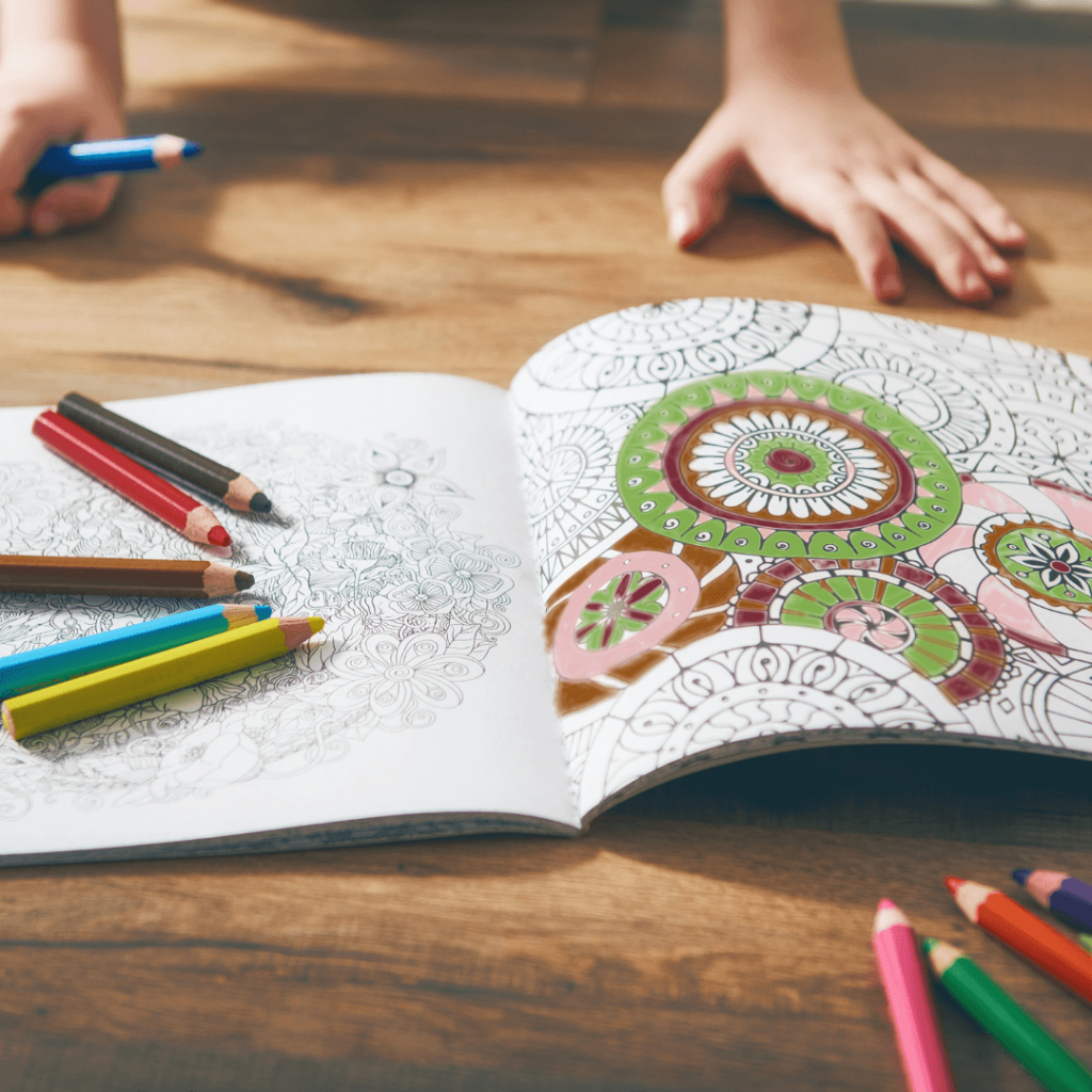A person using a coloring book as a possible method to help manage their  stress.