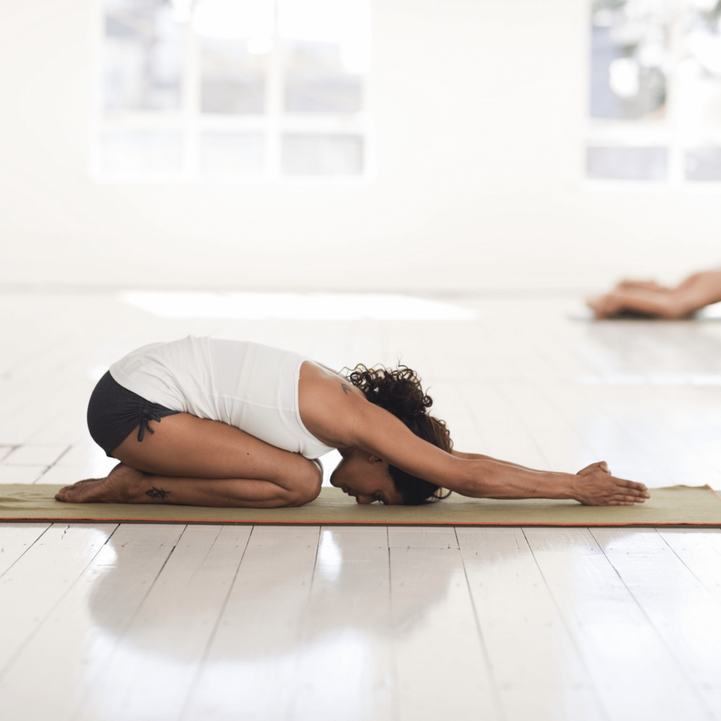 A person doing yoga as a way to help them relax.